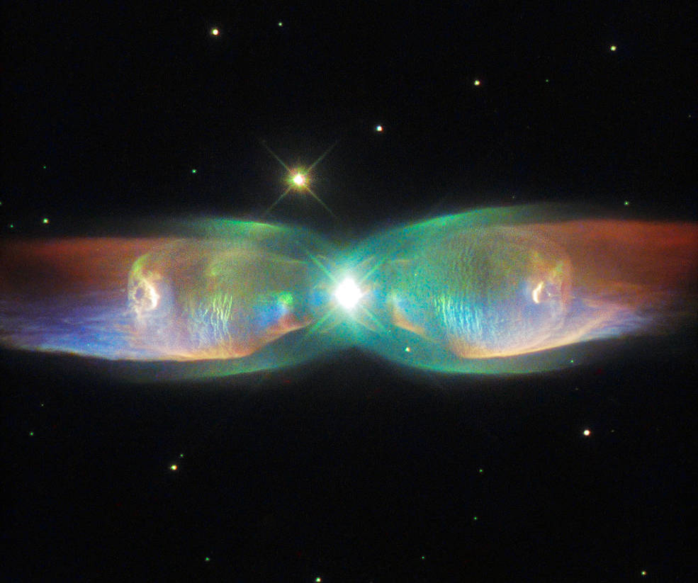 The shimmering colors visible in this NASA/ESA Hubble Space Telescope image show off the complexity of the Twin Jet Nebula.