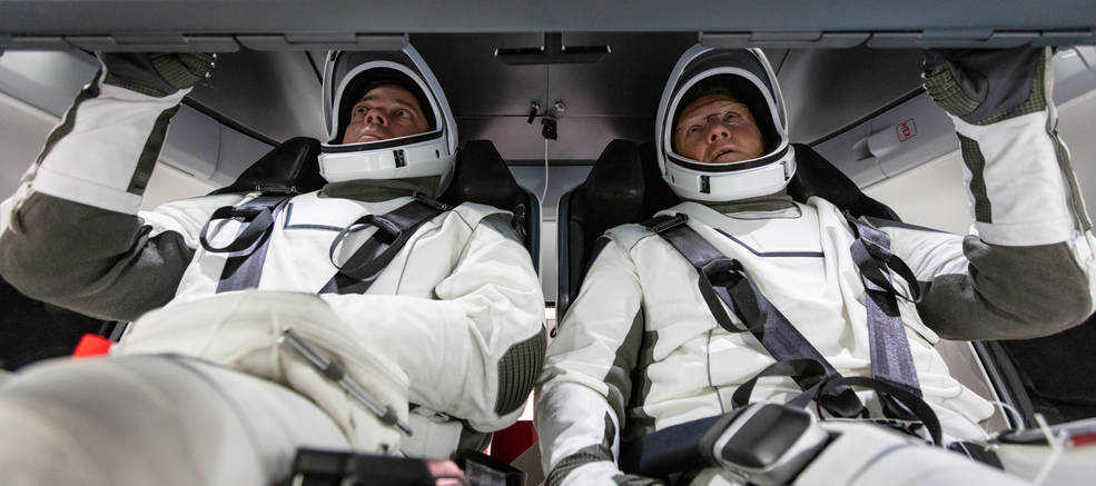 NASA astronauts Doug Hurley and Bob Behnken familiarize themselves with SpaceX's Crew Dragon