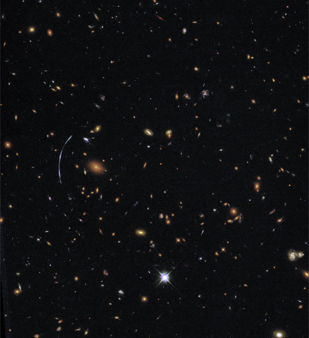 hubble image showing a lensed galaxy among many