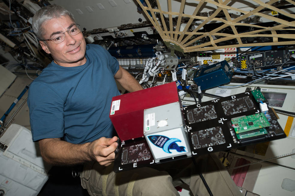 Flight Engineer Mark Vande Hei swaps out a payload card from the TangoLab-1 facility and places into the TangoLab-2 facility