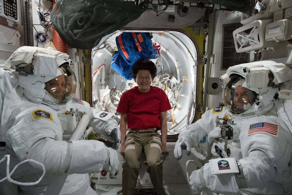 Expedition 56 NASA astronauts Ricky Arnold (left) and Drew Feustel (right) are pictured with Norishige Kanai (center) from JAXA