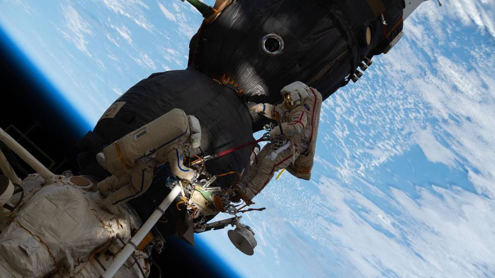 Russian spacewalkers Oleg Kononenko and Sergey Prokopyev work outside the International Space Station