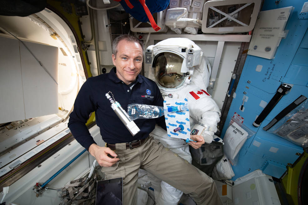 View of Expedition 58 flight engineer (FE) David Saint-Jacques collecting breath, ambient air, and blood samples