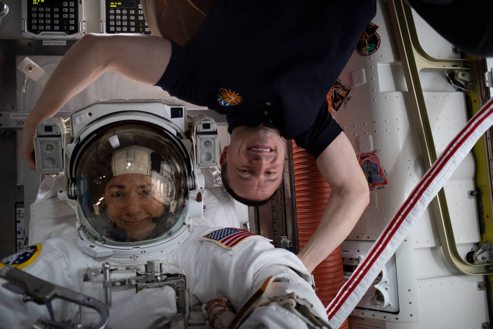 NASA astronauts Jessica Meir, left, and Andrew Morgan pose for a photo in the Quest Airlock prior to a spacewalk on Oct. 18, 201