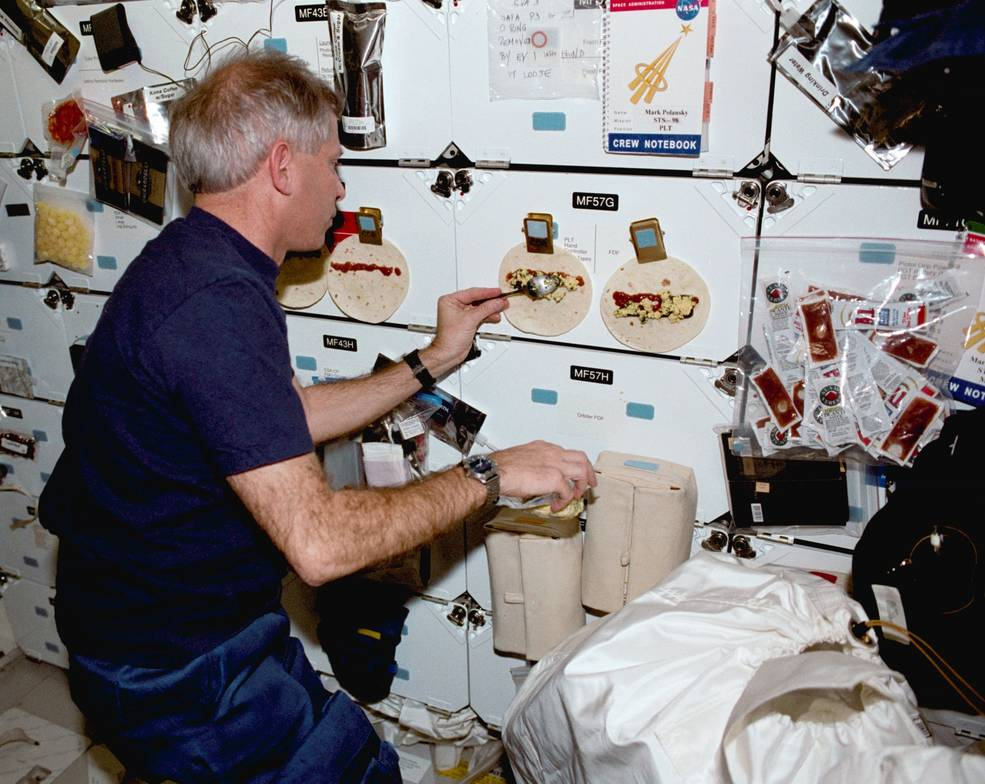 iss20_sts_98_cockrell_fixing_breakfast_burritos