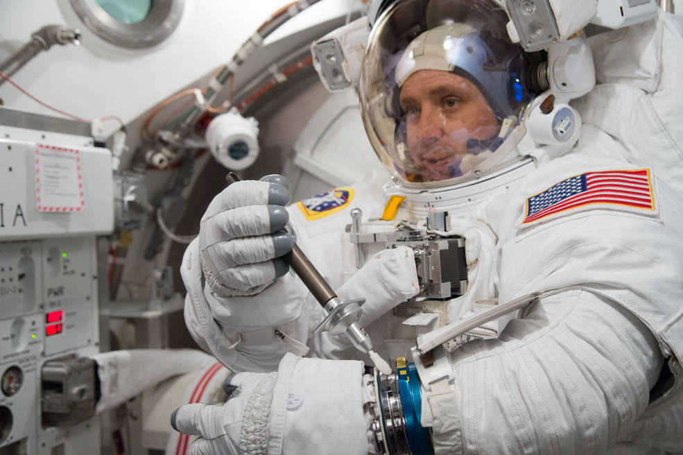Jack Fischer, Expedition 51/52 crew member, training in the Extravehicular Mobility Unit in the Space Station Airlock Test