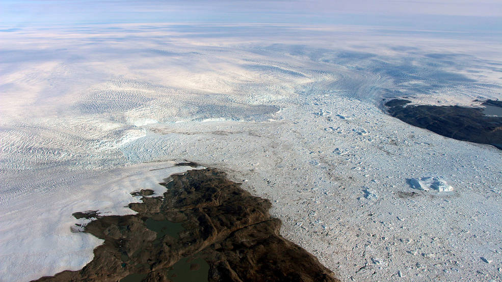 The calving front of Jakobshavn Glacier, center