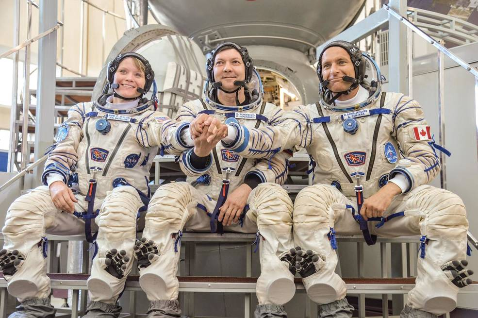 Expedition 58 crew members Anne McClain, Oleg Kononenko and David Saint-Jacques