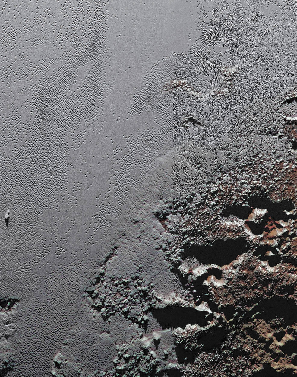 NASA's New Horizons spacecraft zooms in on the southeastern portion of Pluto's great ice plains, where at lower right the plains