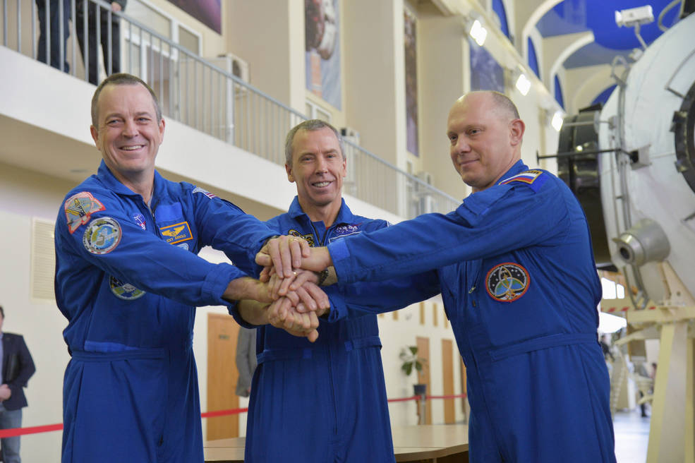 NASA astronauts Drew Feustel and Ricky Arnold, and cosmonaut Oleg Artemyev of the Russian space agency Roscosmos.