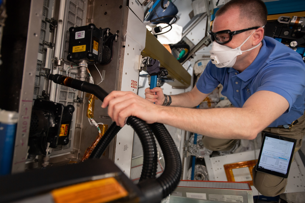 Expedition 59 flight engineer and NASA astronaut Nick Hague replaces filters inside the International Space Station