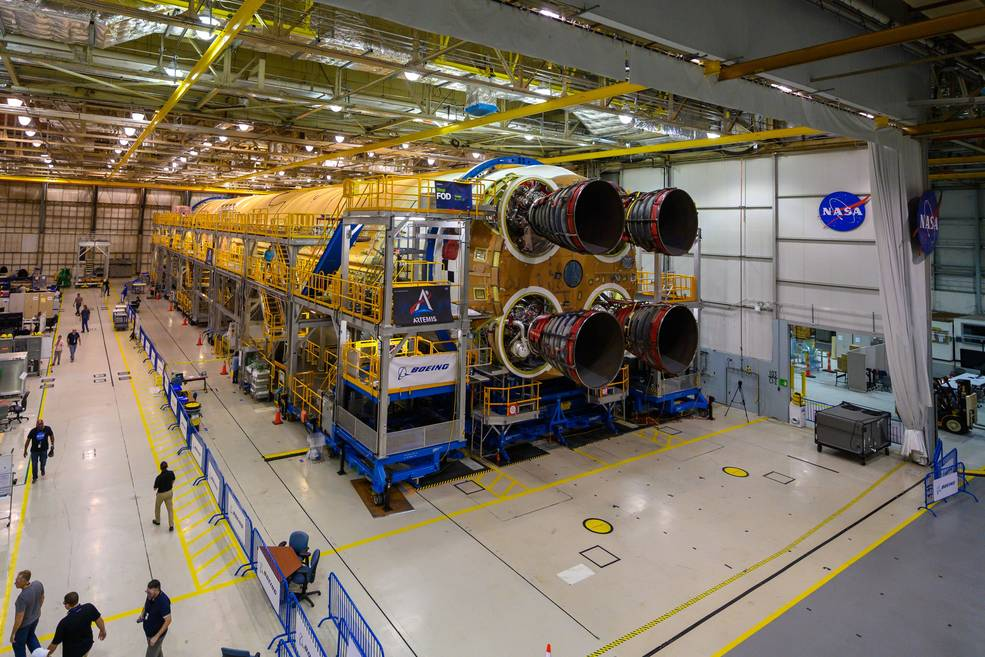 Engineers and technicians attached the last of four RS-25 engines that will provide the necessary thrust for the SLS rocket