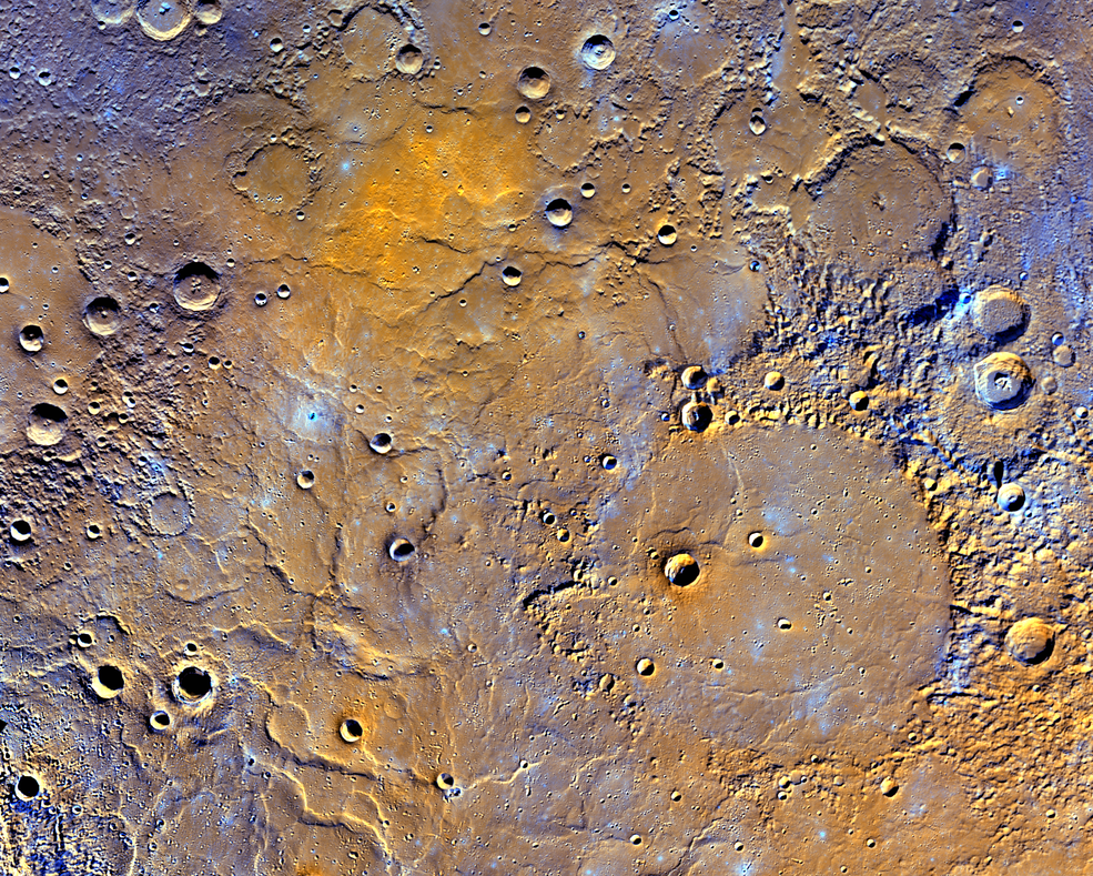 Mercury's northern volcanic plains is shown in enhanced color to emphasize different types of rocks on Mercury's surface