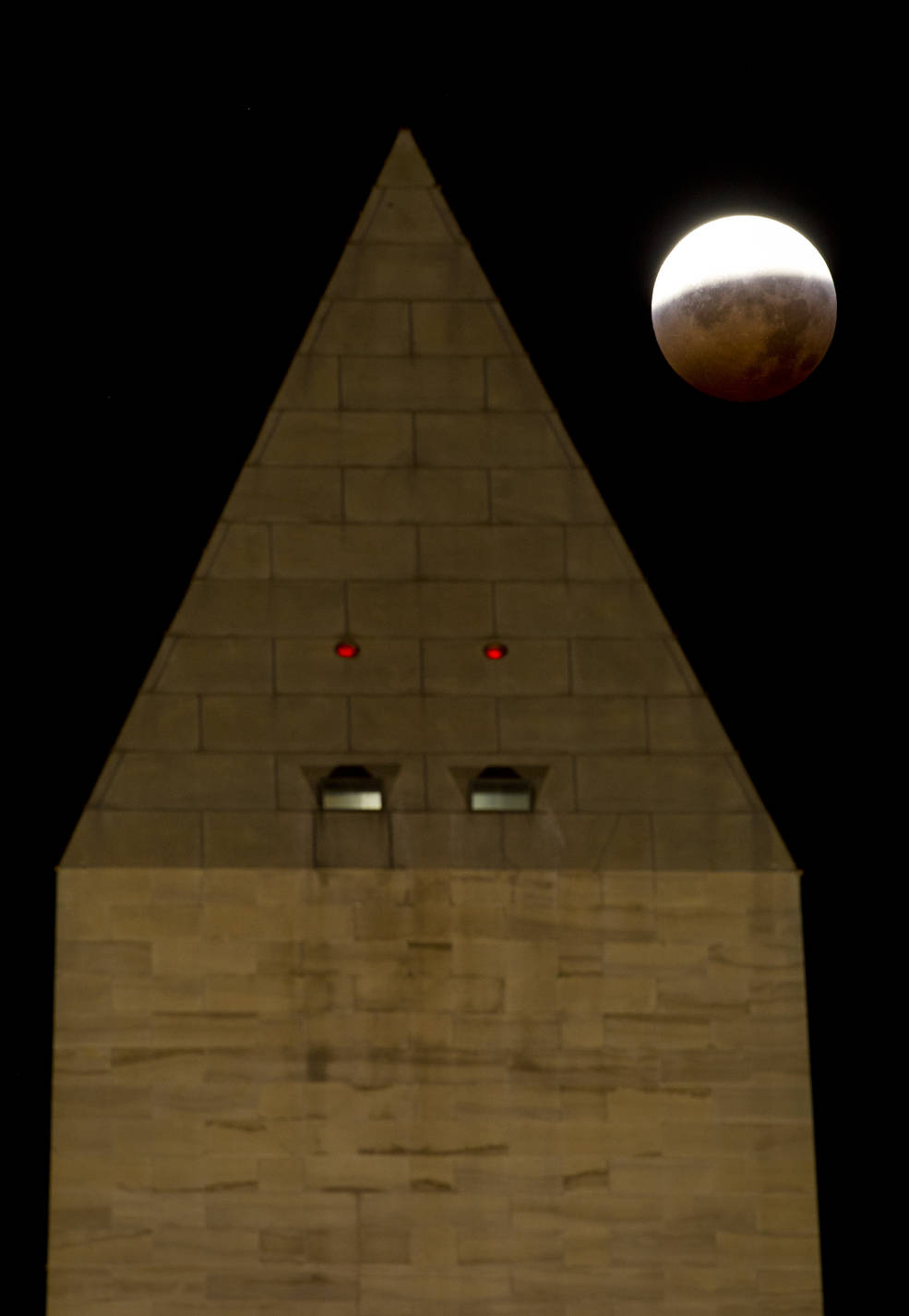 Super moon with the top of the Washington Monument