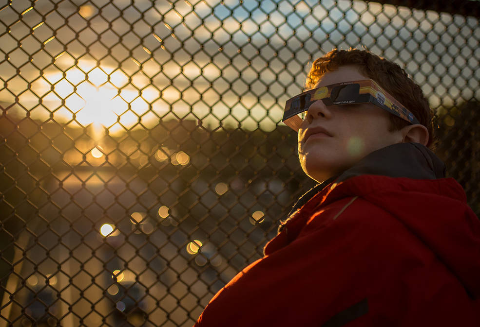 young boy with viewing glasses on
