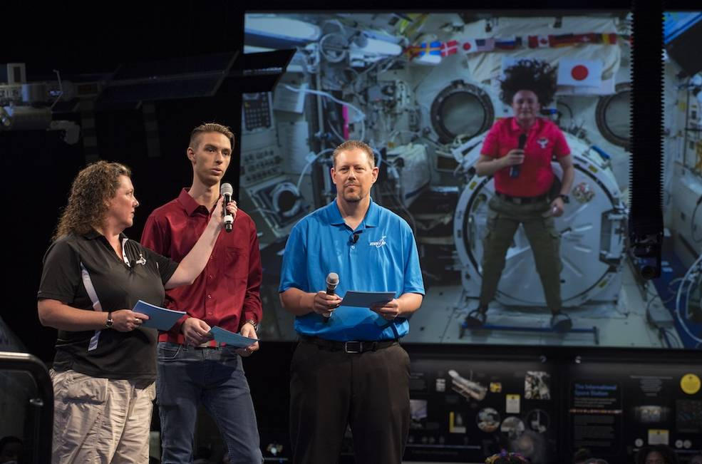Austin Suder asks NASA astronaut Serena Auñon-Chancellor a question during a live downlink with the International Space Station
