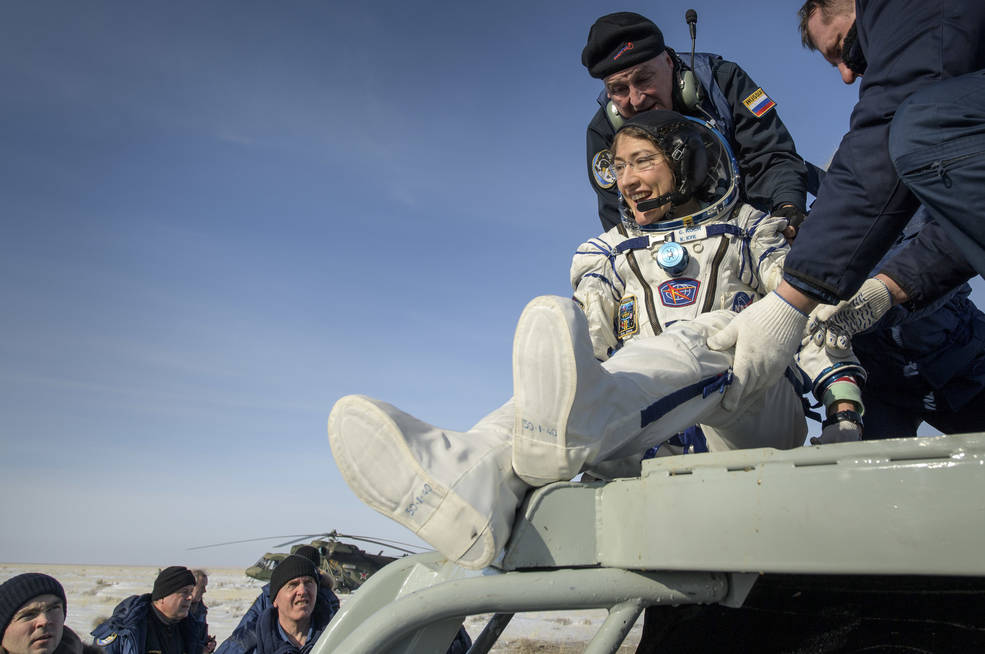 NASA astronaut Christina Koch is helped out of the Soyuz capsule after returning from the space station on Feb. 6, 2020.
