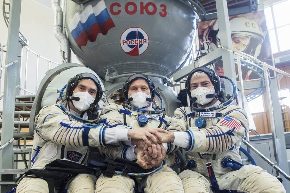 Cosmonauts Pyotr Dubrov of Roscosmos, left, and Oleg Novitskiy, center, of Roscosmos, and NASA astronaut Mark Vande Hei