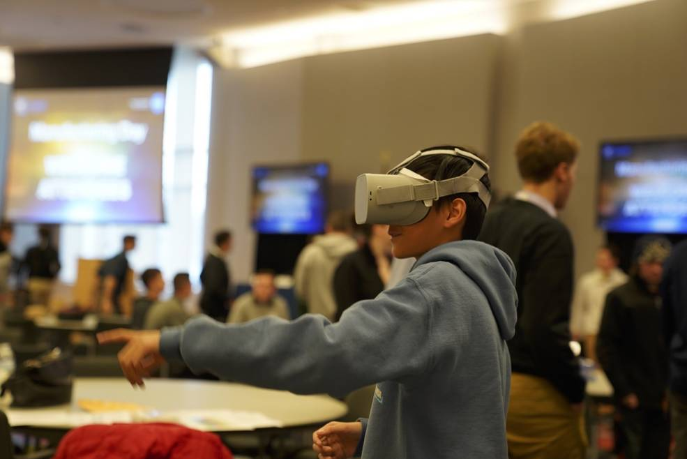 A visitor is immersed in space through a virtual reality tour and learns about space communications.