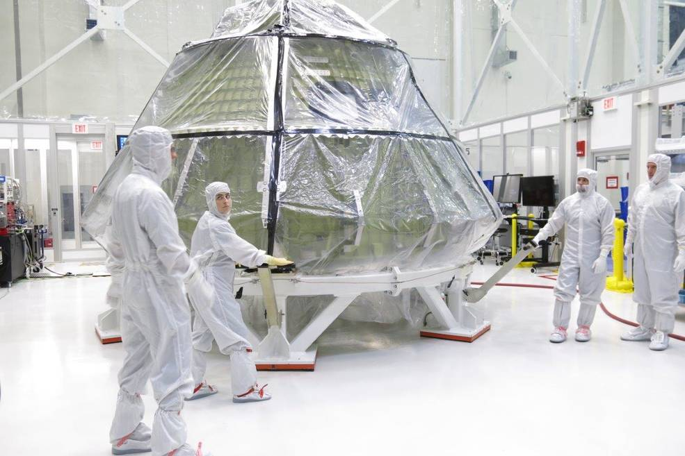 The Orion crew module for Exploration Mission 1 was transferred into the clean room inside the Neil Armstrong Operations and Che