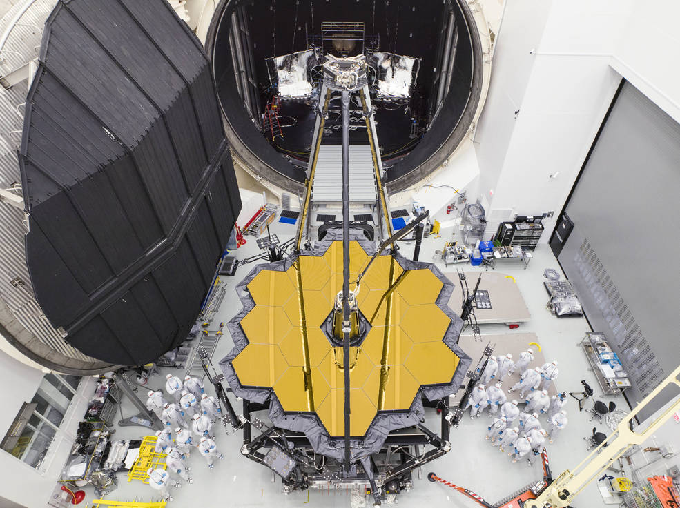Engineers posed by NASA's James Webb Space Telescope shortly after it emerged from Chamber A at NASA's Johnson Space Center.