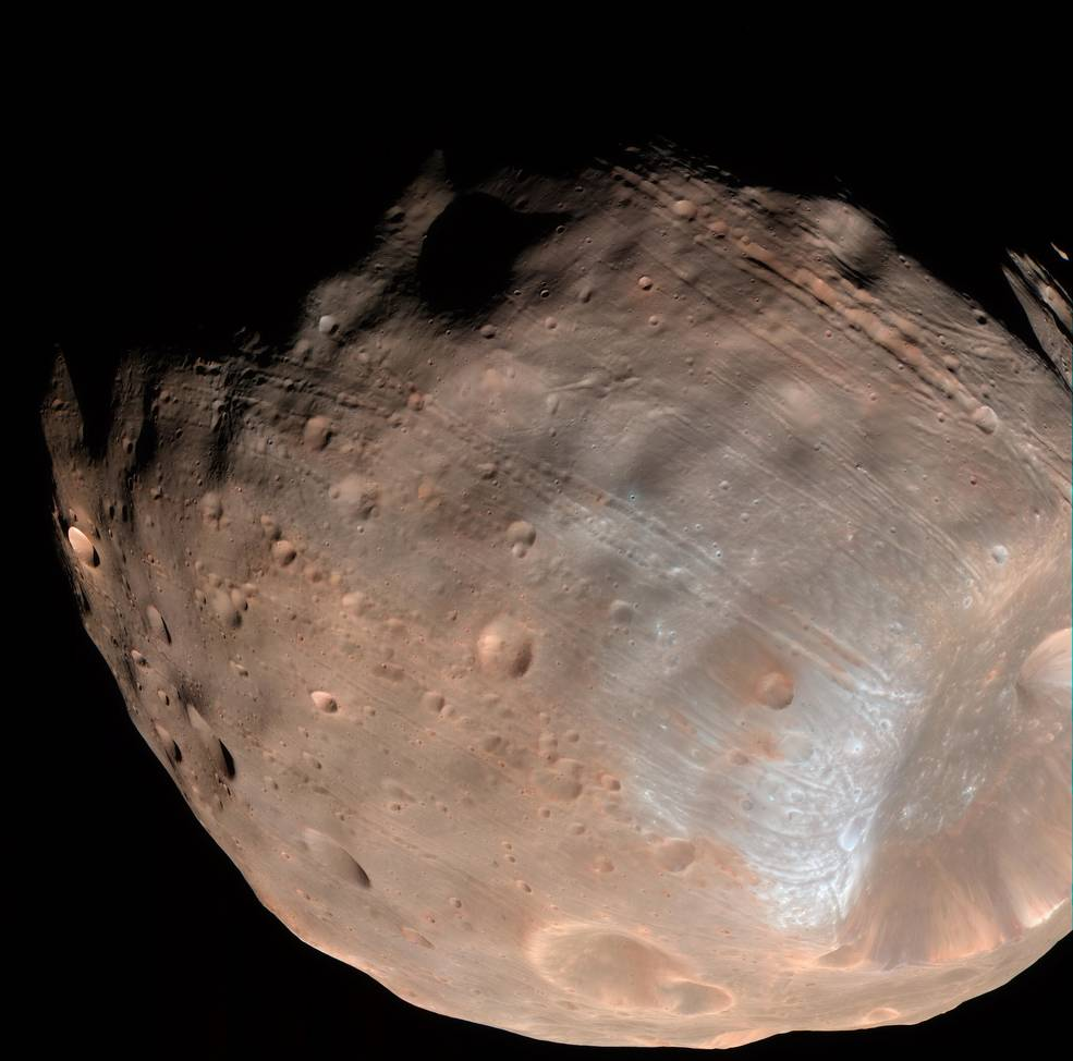 New modeling indicates that the grooves on Mars' moon Phobos could be produced by tidal forces – the mutual gravitational pull of the planet and the moon. Initially, scientists had thought the grooves were created by the massive impact that made Stickney crater (lower right).