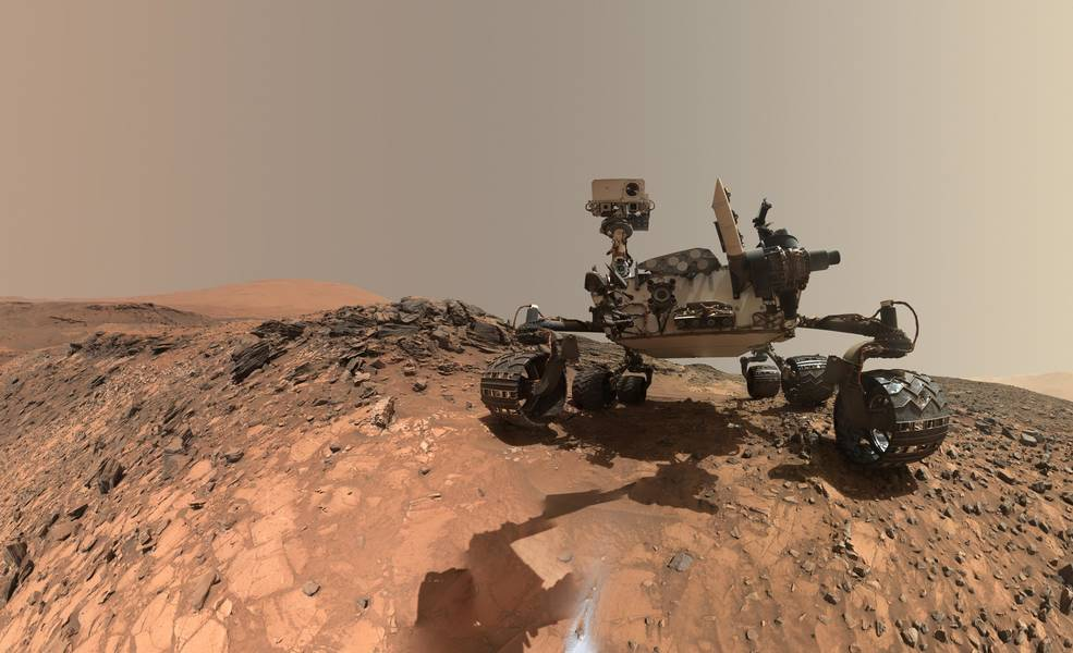 This low-angle self-portrait of NASA's Curiosity Mars rover shows the vehicle at the site from which it reached down to drill in