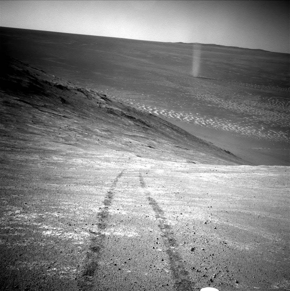 Dust devil on MarsFrom its perch high on a ridge, NASA's Mars Exploration Rover Opportunity recorded this image of a Martian dus