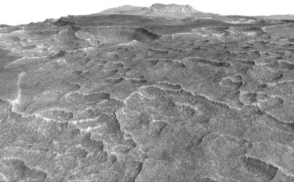 This vertically exaggerated view shows scalloped depressions in a part of Mars