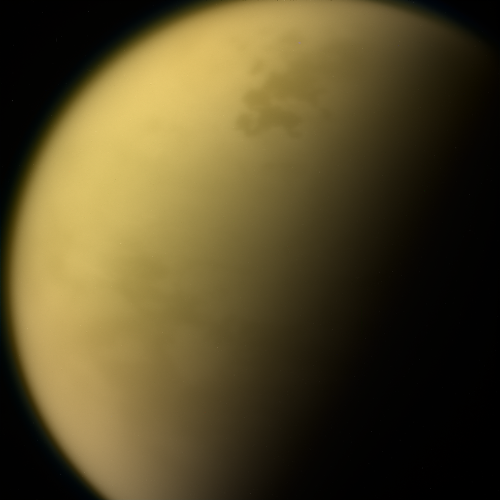 Hazy layers of hydrocarbons enshroud Saturn's moon, Titan. On its surface, methane rivers flow into tar-edged seas.