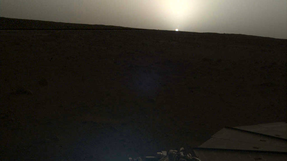 NASA's InSight lander used the Instrument Deployment Camera (IDC) on the end of its robotic arm to image this sunset on Mars on April 25, 2019, the 145th Martian day, or sol, of the mission. This was taken around 6:30 p.m. Mars local time. Credits: NASA/JPL-Caltech