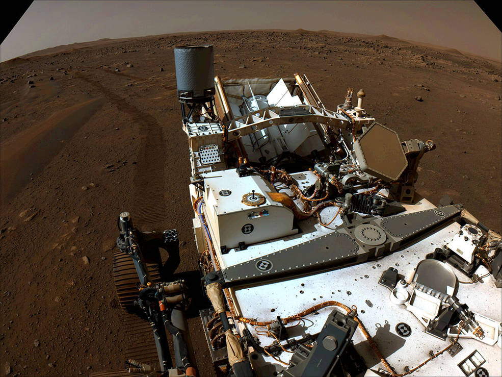 Perseverance looks back with one of its navigation cameras toward its tracks on July 1, 2021 (the 130th sol, or Martian day, of its mission), after driving autonomously 358 feet (109 meters) – its longest autonomous drive to date.