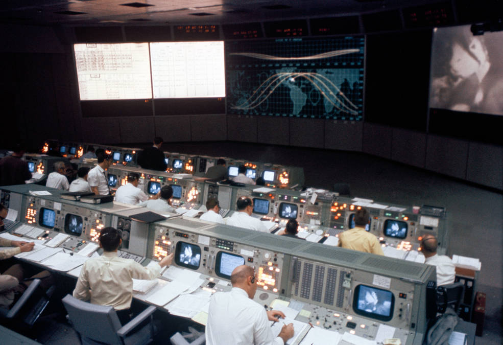 Overall view of the Mission Operations Control Room in the Mission Control Center, Building 30, during the Apollo 9 mission.
