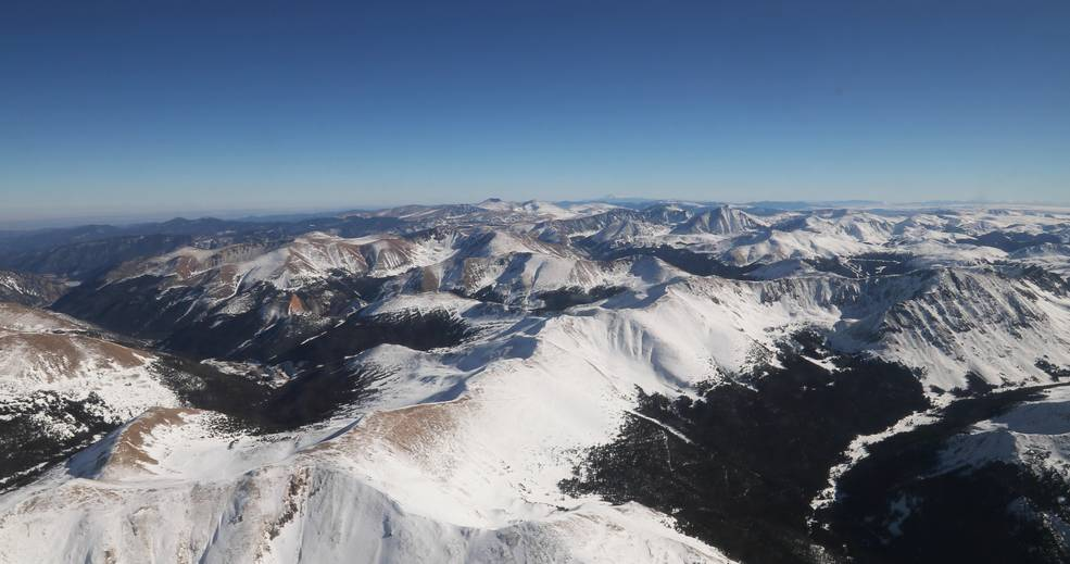 snow-capped mountain landscape against the backdrop of a clear blue sky