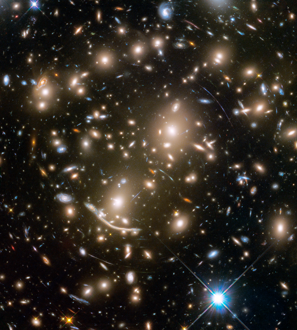 a packed field of galaxies and curved blue streaks