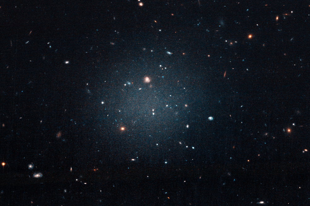 diffuse white blur across a field of galaxies
