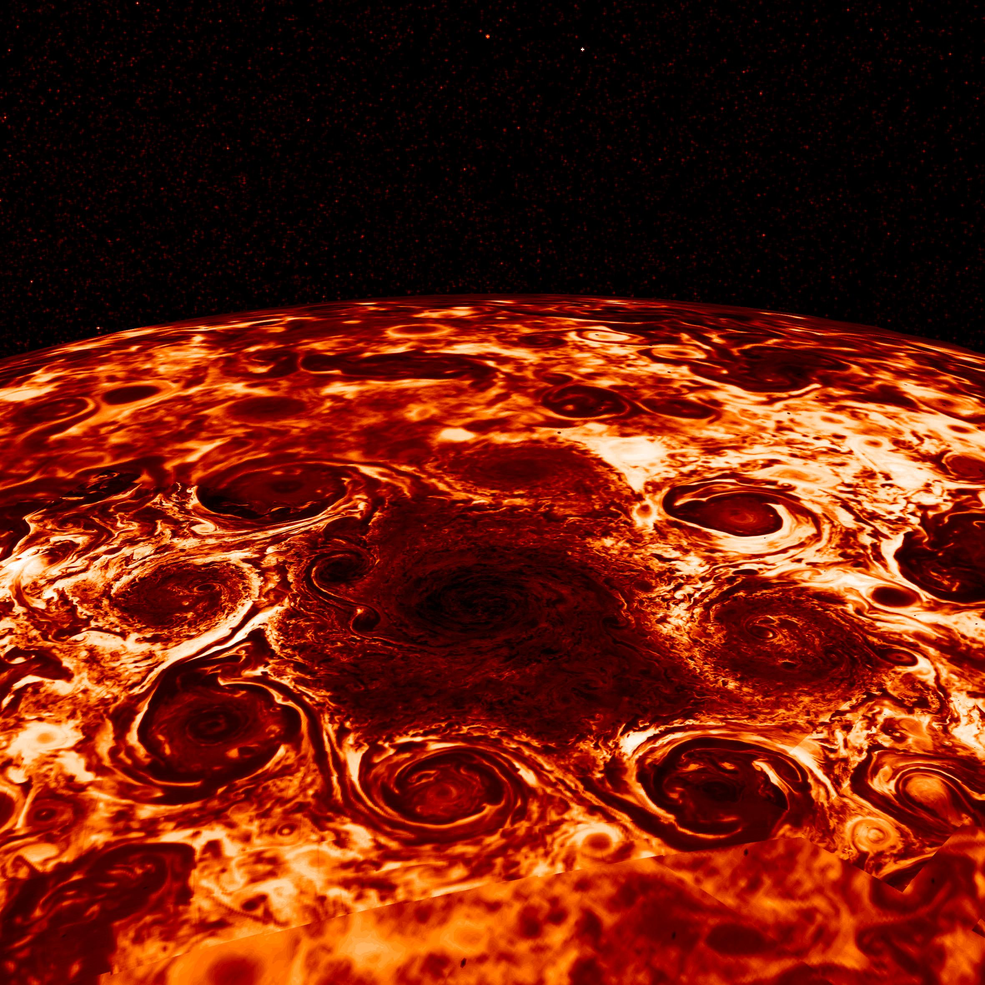 Cyclone storms encircle Jupiter's North Pole, captured in infrared light by NASA's Juno spacecraft.
