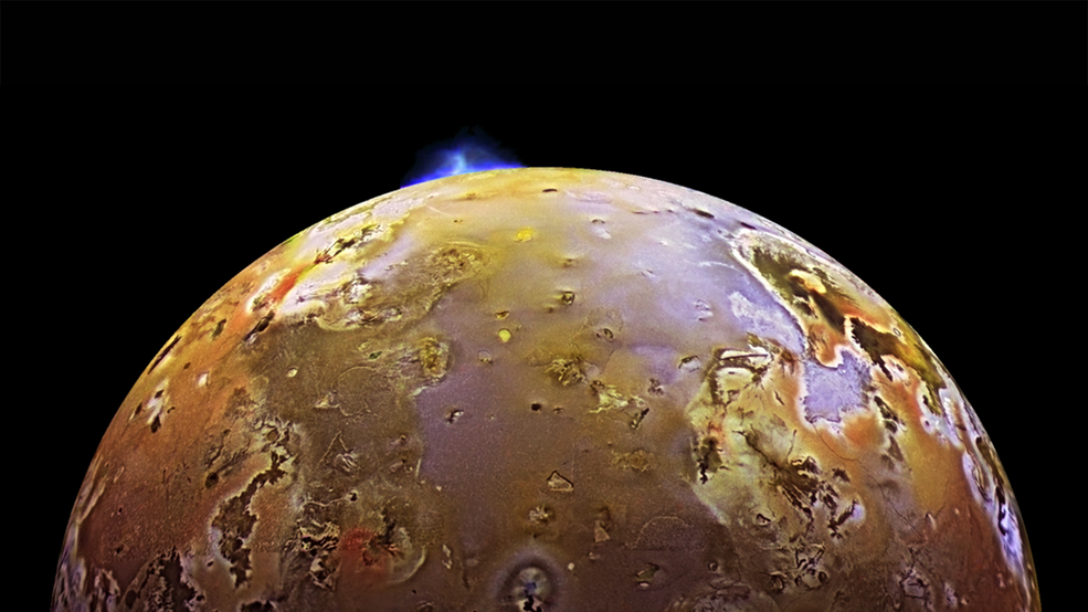 NASA's Galileo spacecraft catches Io in the midst of a volcanic eruption.