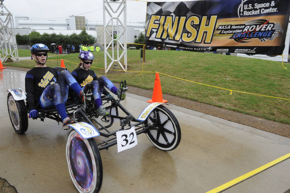 The Greenfield Central High School Rover Team crosses the finish line during the 2015 Human Exploration Rover Challenge.