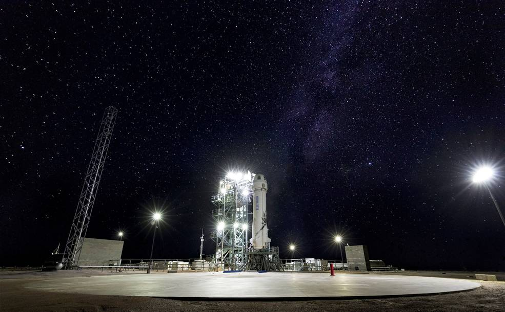 Blue Origin's New Shepard rocket on the launchpad with night sky in background