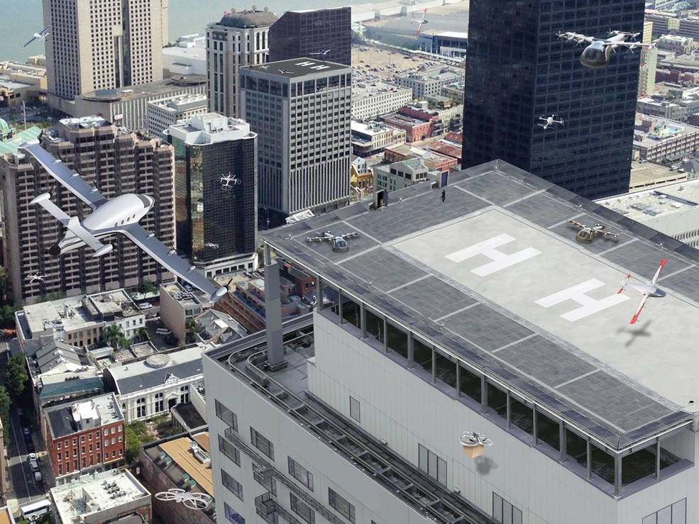 Artist concept of urban air mobility operating within a city.