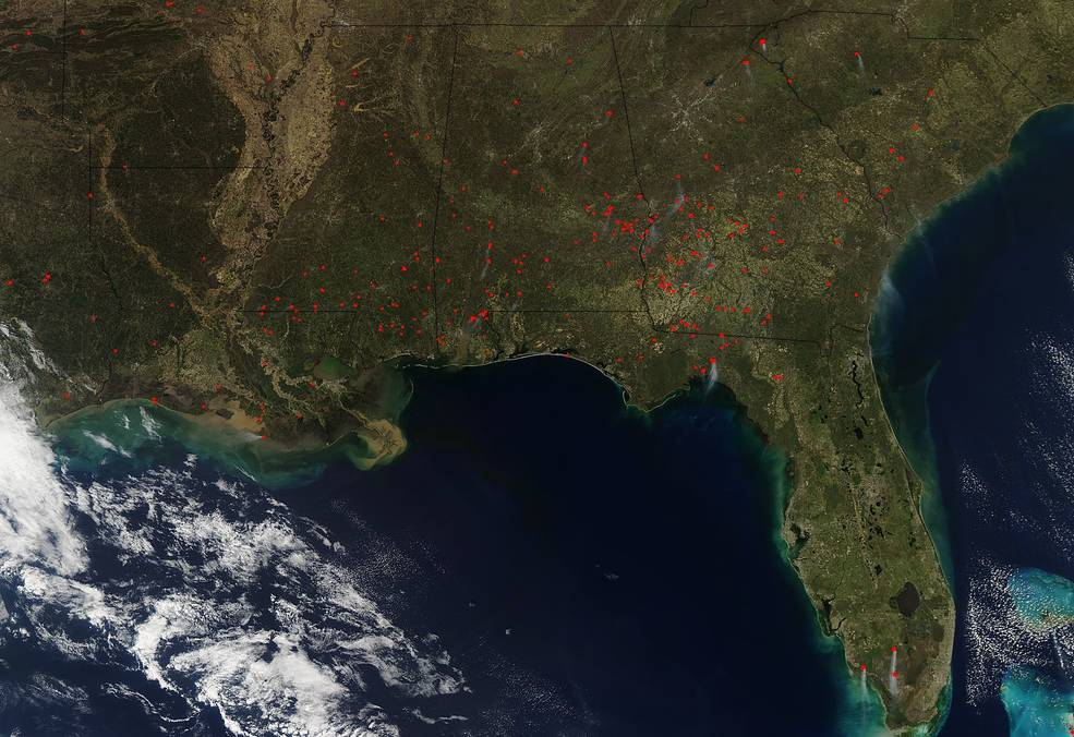 March 2018 image from NASAs Aqua satellite shows actively burning areas in southeastern U.S. are shown as red dots.