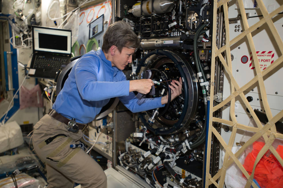 Expedition 51 Commander Peggy Whitson of NASA performs investigative troubleshooting in December 2016