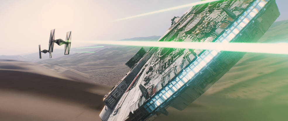 The Millennium Falcon takes on tie fighters in a scene from 'Star Wars: The Force Awakens.' Credit: Disney