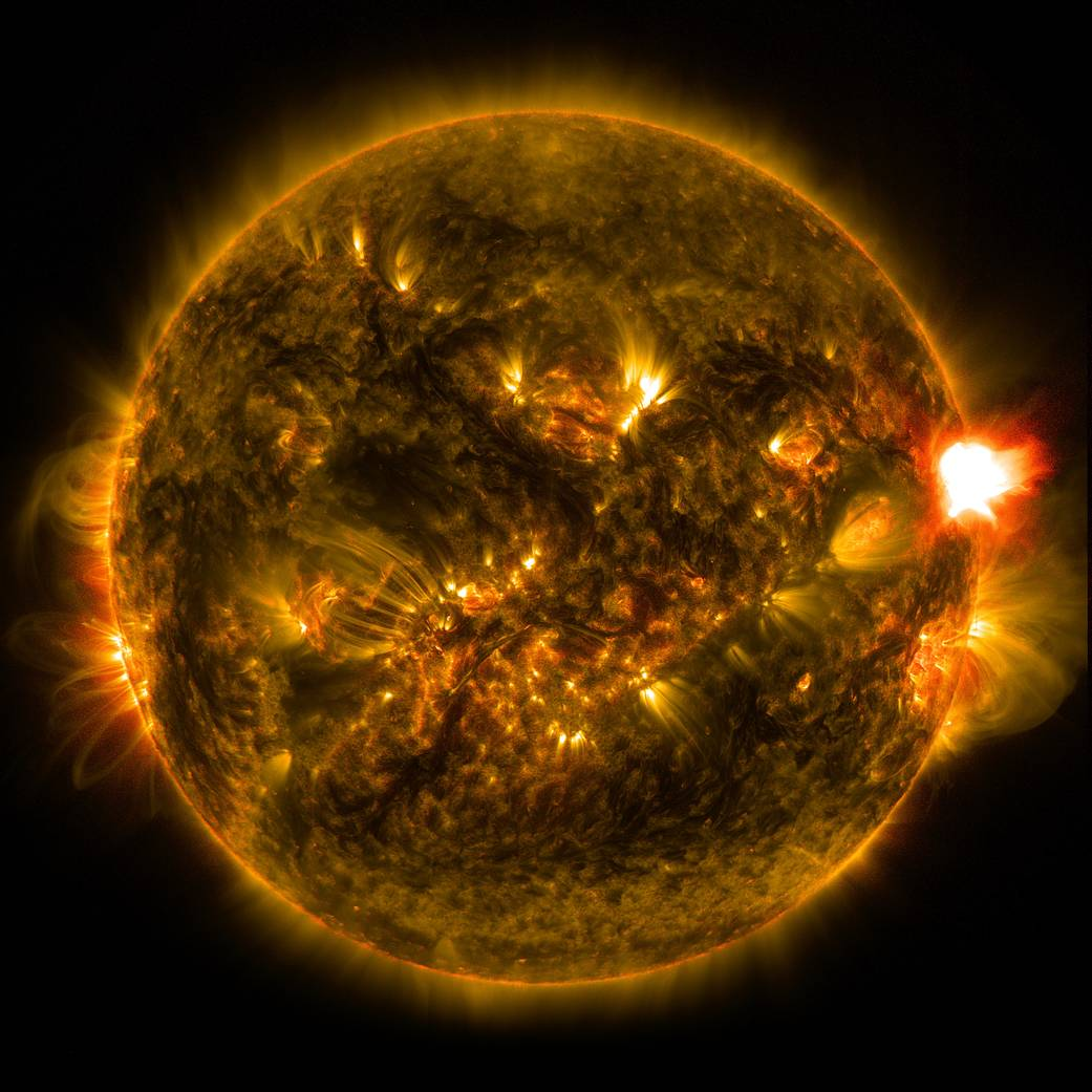 An M-class solar flare erupts from the right side of the sun in this image from shortly before midnight EST on Jan. 12, 2015. Th