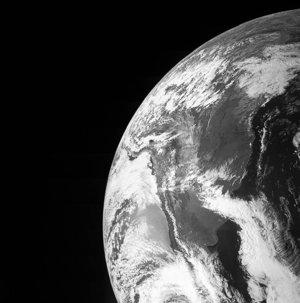 Black and white arc of Earth from orbit