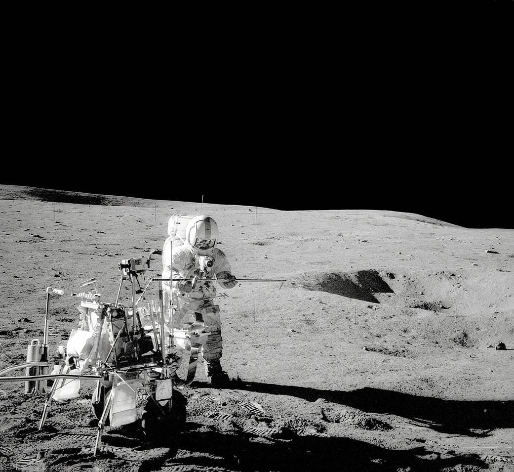 Apollo 14 Commander Alan Shepard stands by the Modular Equipment Transporter (MET).