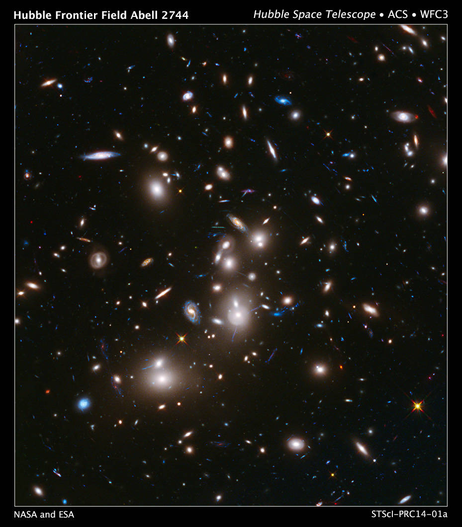 This long-exposure Hubble Space Telescope image of massive galaxy cluster Abell 2744 (foreground) is the deepest ever made of an