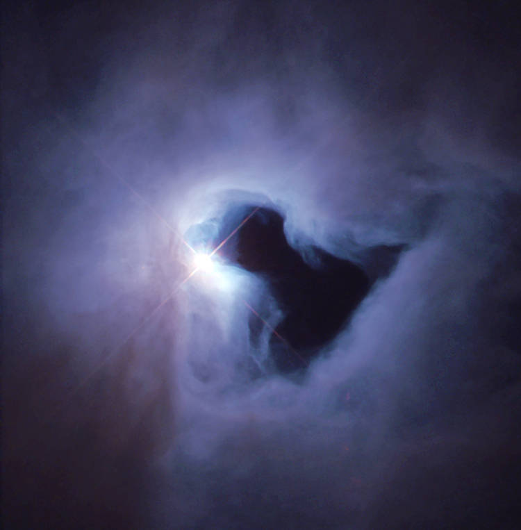 Cloud Of Dust And Gas In Purple With Bright Light Behind Dark Space Resembling Street