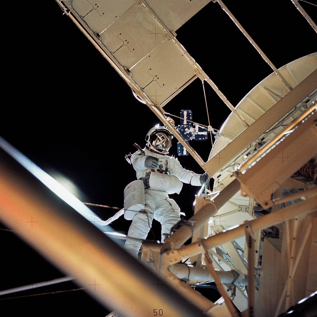 Astronaut Owen K. Garriott retrieves an image experiment from the Apollo Telescope Mount during an extravehicular activity.